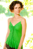 Girl in green vest Royalty Free Stock Image
