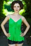 Girl in green vest Stock Image