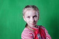 Girl and green wall Stock Image