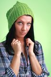 Girl in green woollen cap Stock Photo