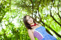 Girl by the greenery Royalty Free Stock Photography