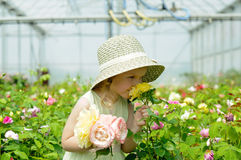 Girl in a greenhouse Stock Image