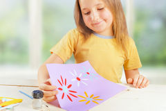 Girl with greeting card for mother Royalty Free Stock Photography