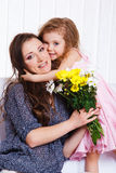Girl greeting  mother Stock Image