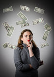 Girl in grey and dollars. Stock Photography