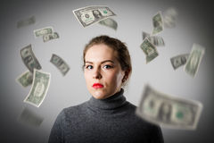 Girl in grey and dollars. Royalty Free Stock Photo