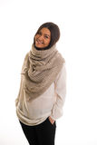 A girl in a grey knitted scarf smiling. Royalty Free Stock Photography