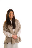 A girl in a grey knitted scarf smiling. Stock Photography