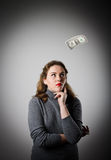 Girl in grey and one dollar. Royalty Free Stock Images