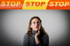 Girl in grey and STOP line. Royalty Free Stock Photography