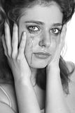 The girl in grief. Close-up portrait of a girl in grief (monochrome image royalty free stock photo
