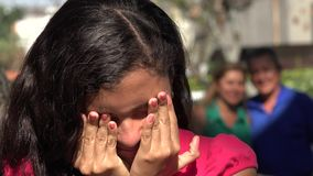 Girl Grieving While Parents Watch. Stock video of girl upset while parents watch stock video