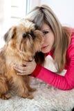 Girl and Griffon Bruxellois Stock Photos
