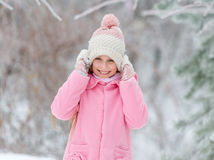 Girl grinning happily in the forest Stock Photography