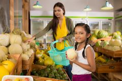 Girl at grocery store Royalty Free Stock Images