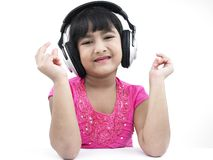 Girl grooving to the music. Asian girl of indian origin listening to music Stock Photos