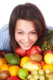Girl with group of fruit. Stock Photo