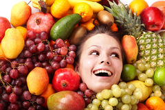 Girl in group of fruit. Royalty Free Stock Photography