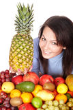 Girl with group of fruit and  pineapple. Stock Photo
