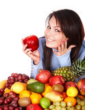 Girl with group of fruit and vegetables. Stock Photo