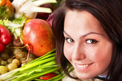 Girl with group of fruit and vegetables. Stock Photos