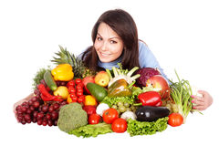 Girl with group of fruit and vegetables. Stock Photography