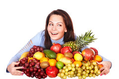 Girl with group of fruit and vegetables. Stock Image