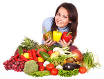 Girl with group of fruit and vegetables. Royalty Free Stock Photos