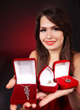 Girl with group jewellery box on red background. Royalty Free Stock Images