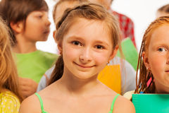 Girl in the group of kids close-up portrait Royalty Free Stock Photo