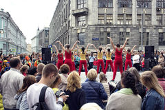Girl group performs and many people watch them Stock Image