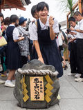 Girl group touch Jishu Jinja shrine in kiyomizu temple Royalty Free Stock Photo