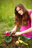 Girl grow flower stock photo