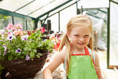 Girl Growing Plants In Greenhouse Royalty Free Stock Photo