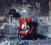Girl  in  grunge interior. Little girl sitting in  grunge interior (Photo and hand-drawing elements combined Stock Image