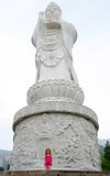 A Girl and a Guanyin Colossus Royalty Free Stock Photos