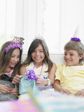Girl With Guests And Birthday Presents Royalty Free Stock Image