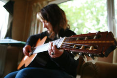 Girl with Guitar. Young Guitar Performer With Guitar stock image