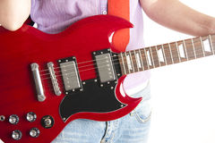 Girl with guitar. Performing on isolated background Royalty Free Stock Photography