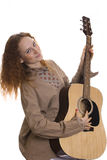 Girl with a guitar. Beautiful red-haired girl with a guitar Stock Photo