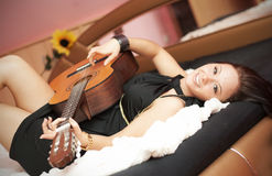 Girl with guitar. Young beauty music girl with guitar Stock Photo