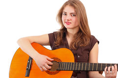Girl with guitar Stock Images