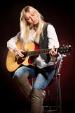 Girl with a guitar Royalty Free Stock Photos