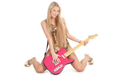 Girl with guitar. Pretty girl sitting with pink electric guitar Royalty Free Stock Photos