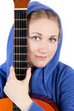 Girl and guitar. Pretty young girl with the guitar closeup Royalty Free Stock Photos
