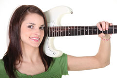 A girl with a guitar Stock Image