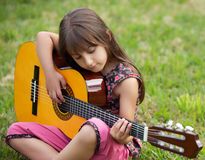 Girl with a guitar Stock Photography