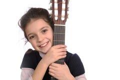 Girl and guitar Stock Photos