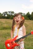 The girl with a guitar Stock Photos