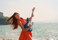 Girl with a guitar on the beach Royalty Free Stock Photography
